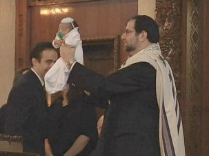 Ancient Ritual: Cantor Philip L. Sherman performs a bris at a Long Island synagogue.