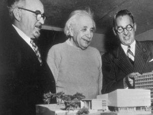 Model Med: Albert Einstein checks out scale model of Yeshiva University's medical school in the Bronx. He is flanked by Yeshiva University president, Samuel Belkin (left) and New York's attorney general, Nathaniel Goldstein.]