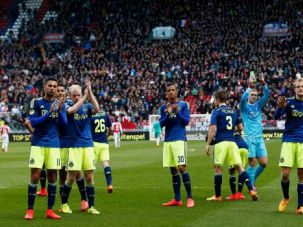Players for Dutch soccer team Ajax applaud traveling supporters after Utrecht fans hurled anti-Semitic abuse.