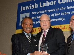 Sounding Sorry: Rev. Al Sharpton presented the Jewish Labor Committee's Human Rights Award to Lee Saunders (center), president of the American Federation of State, County and Municipal Employees, standing beside the JLC's president, Stuart Appelbaum (right), at the group's awards dinner in New York,