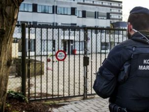 Dutch police officer stands guard at Jewish school in Amsterdam.