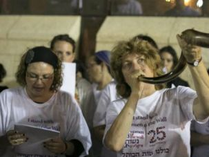 New Year?s Eve: Women of the Wall leader Anat Hoffman blows shofar at Western Wall during Selichot prayer service.
