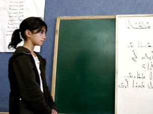 Not-So-Dead Language: A student listens to Israeli Arab teacher Amir Khalul (not seen) during Aramaic class in the Israeli Arab village of Jish.