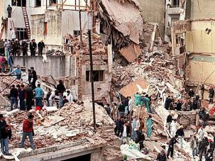Deadly Day: Rescuers pick through the rubble of a deadly 1994 blast that struck a Jewish center in Argentina. The bombing of a bus in Bulgaria took place 18 years to the day after the Buenos Aires bombing.