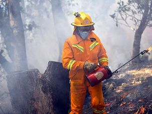 Deadly Blaze: Firefighters work to battle wildfires that have ravaged parts of Australia, forcing members of the Jewish community to flee.