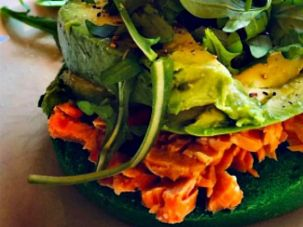 This shamrock bagel takes a healthy turn with cooked salmon,  avocado and arugula. The overabundance of green allows the salmon to really stand out.