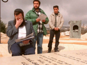 Kach leader Baruch Marzel wipes his eyes at the grave of Baruch Goldstein, who killed 29 Palestinians in Hebron.