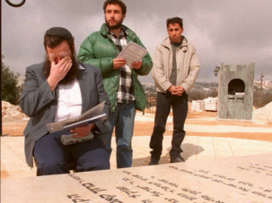 Right-wing activist Baruch Marzel wipes his eyes at the grave of Baruch Goldstein, who killed 29 Palestinians in Hebron.