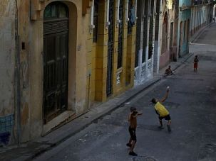 Children play baseball in the streets of Old Havana.
