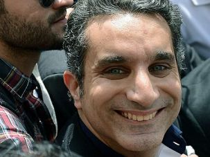 **Marked Man **: Egyptian TV satirist Bassem Youssef arrives at a Cairo prosecutor?s office surrounded by supporters.