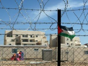A small Palestinian flag attached to a fence outside the Israeli settlement of Beitar Illit, on the outskirts of Jerusalem.