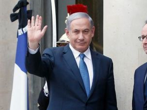 Chilly Meeting: French President Francois Hollande makes little effort to cover up his displeasure at the decision of Benjamin Netanyahu to attend the anti-terror march in Paris.