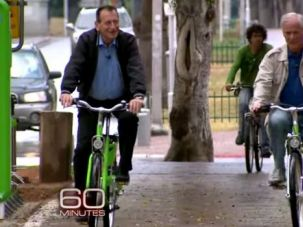 Riding for a Story: Bob Simon rides alongside Mayor Ron Huldai in 2012 for a 60 Minutes story about Tel Aviv.