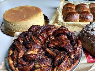 Clockwise from bottom left, Breads Bakery babka pie, pumpkin cheese cake, pumpkin dinner rolls and autumn loaf.