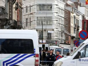 Deadly Attack: Policemen block streets near the Jewish Museum in Brussels after a gunman shot and killed three people.