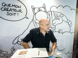 A cartoonist shows off his work at last year's International Comics Festival in France.