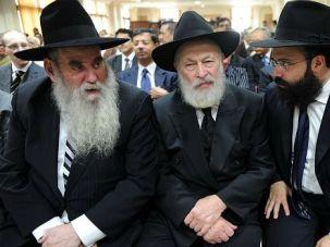 Transition Time? Rabbi Moshe Kotlarsky (left) and Rabbi Yehuda Krinsky (center) join Rabbi Abraham Berkowich in Mumbai, India, at a November 2009 memorial service for a Chabad family slain in a terrorist attack.