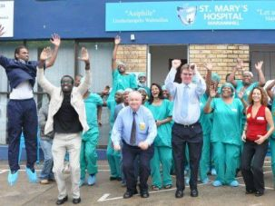 Celebrating Circumcision: Israeli health professionals celebrate with South African colleagues after completing a training mission.