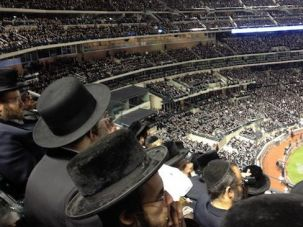 Mixed Messages: Smart phones and laptops were everywhere as black-hatted Hasidic men rushed to a rally where leaders denounced the corrupting power of the internet.