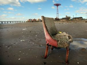 After the Storm: A damaged chair sits on the beach in Coney Island in the wake of Superstorm Sandy.