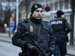 End of Road: Police stand guard after a suspect was killed in the twin terror shootings on an arts center and a synagogue.