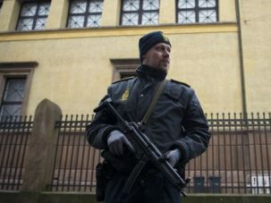 Aftermath: A police officer stands guard outside the synagogue Krystalgade in Copenhagen.