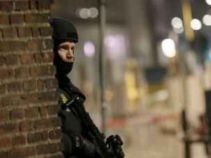 Terror in Denmark Copenhagen police officer stands guard near Great Synagogue, where a man was killed by a suspected terrorist gunman.