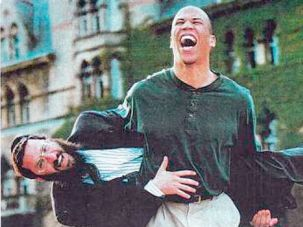 Future Leaders: Cory Booker playfully lifts Rabbi Shmuley Boteach during a year the Rhodes Scholar spent at Oxford University in England.