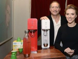 Soda, Scarlett and Me: CEO Daniel Birnbaum poses with SodaStream home beverage machines — and superstar spokesperson Scarlett Johansson.