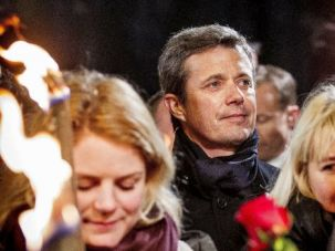 Prince of Peace: Denmark's Crown Prince Frederick marches with thousands of Danes against terror after the shootings that killed two over the weekend.