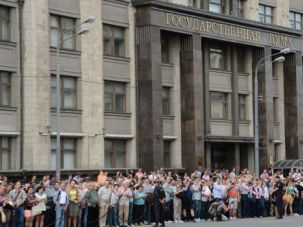 People crowd in front of the State Duma in central Moscow.