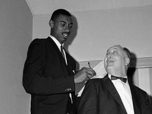 What's Up, Wilt? Eddie Gottlieb, who was honored at South Philadelphia High School, peers up at Wilt Chamberlain in 1959.