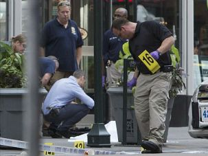 Shooting Probe: Police investigate the aftermath of deadly shooting outside Empire State Building in Manhattan.