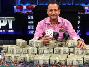 Poker Face: Eric Afriat displays the tournament winnings he raked in while skipping his mother's Passover Seders.