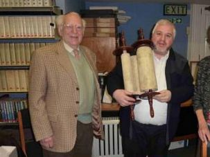 Happy Return: Museum officials return 250 year old Torah scroll to the Jewish community of Cornwall in England.