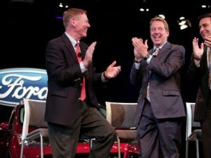 Ford CEO Mark Fields (right), executive chairman Bill Ford (left) and outgoing CEO Alan Mulally.