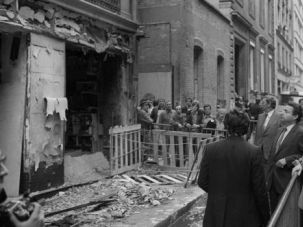 Case Closed? Then-Paris Mayor Jacques Chirac looks at the damage after a bomb attack at Synagogue Rue Copernic killed four people in 1980.