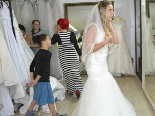 Wedding Wonder: Gal Eden tries on a wedding dress at a Jerusalem charity catering to brides-to-be.