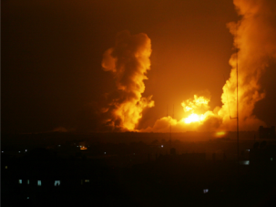 Hitting Back: A ball of fire is seen following an Israel airstrike in Rafah, southern Gaza, on July 1, 2014.