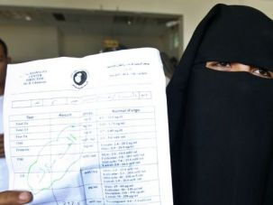 Proud Mom: Hana al-Za-anin shows off hospital documents after she became pregnant with sperm from her husband smuggled out of an Israeli prison.