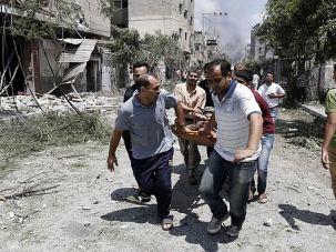 Run for LIves: Desperate Palestinians carry body from streets of Gaza's Shejaia neighborhood after fierce shelling kills dozens of civilians.