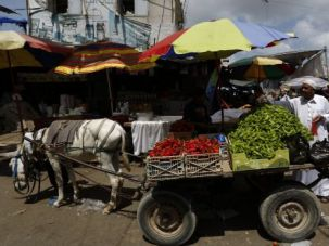 Quiet No More: Gaza residents return to a makeshift market as Israel accepted a ceasefire plan. The shaky truce looked in doubt after rockets from Gaza kept flying and Israel resumed strikes.