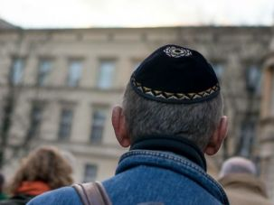 German man participates in silent march commemorating the anniversary of the Kristallnacht Nazi pogrom.