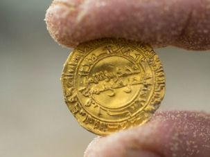 'Gleaming' Find: Archeologist shows off gold coin recovered from a shipwreck off the Israeli coast.