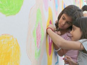 Jewish and Arab students working on a project together at the Max Rayne Hand In Hand Jerusalem School.