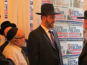 Changing Times: Grand Rabbi David Eichenstein, a Brooklyn Hasidic spiritual leader meets with state Senate candidate Simcha Felder. Such overt political activity was once unheard of for the ultra-Orthodox. But things are changing.