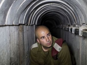 North and South: An Israeli officer inspects tunnel under border with Gaza. Are Lebanese militants using the same tactic in the north?