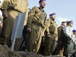 Grim Ritual: Stony-faced soldiers mourn an Israeli comrade shot dead in Hebron. Despite the angst, Israelis must understand the facts show violence is way down.