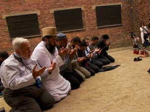 Muslim clerics pray at the Auschwiz concentration camp in Poland during a visit in May to learn about the Holocaust.