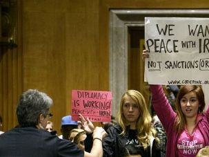 Demonstrators from the anti-war group Code Pink protest at congressional vote